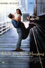 Фільм Поки ти спав - Постери